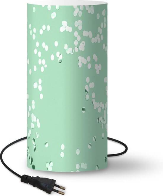 Mintgroene lamp in babykamer