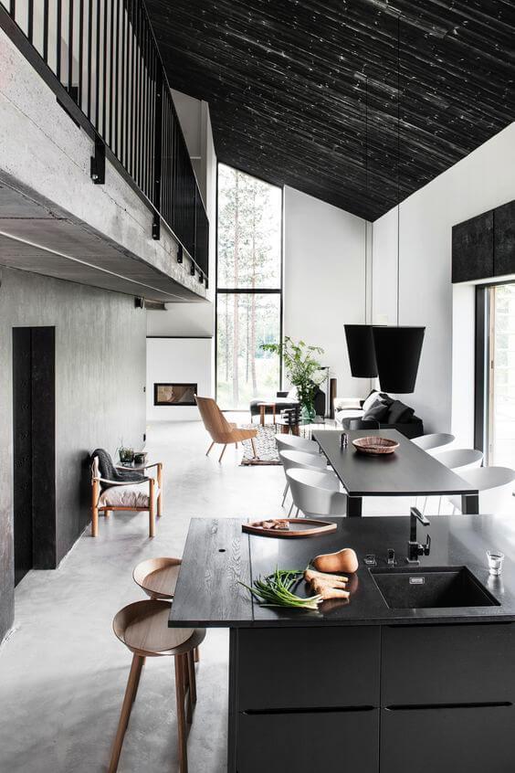 Moderne woonkeuken met betonnen muren en vloer