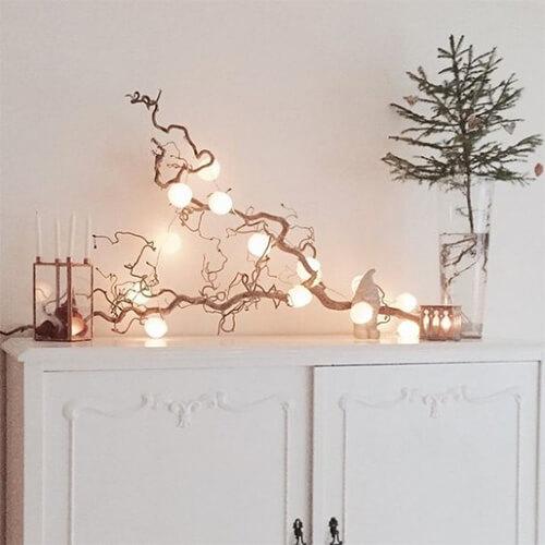 Winterdecoratie tak met lichtjes