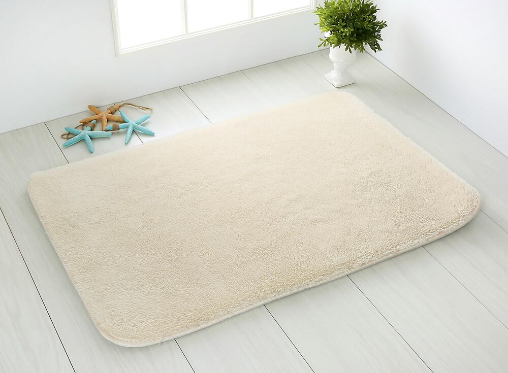 Witte strakke badmat