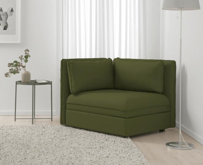 Groene fauteuil met hoekvorm